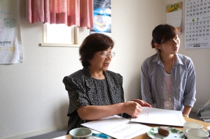 "Ishida-san and her assistant, Yuri Sanpei, seated at their cozy ""office"" table."